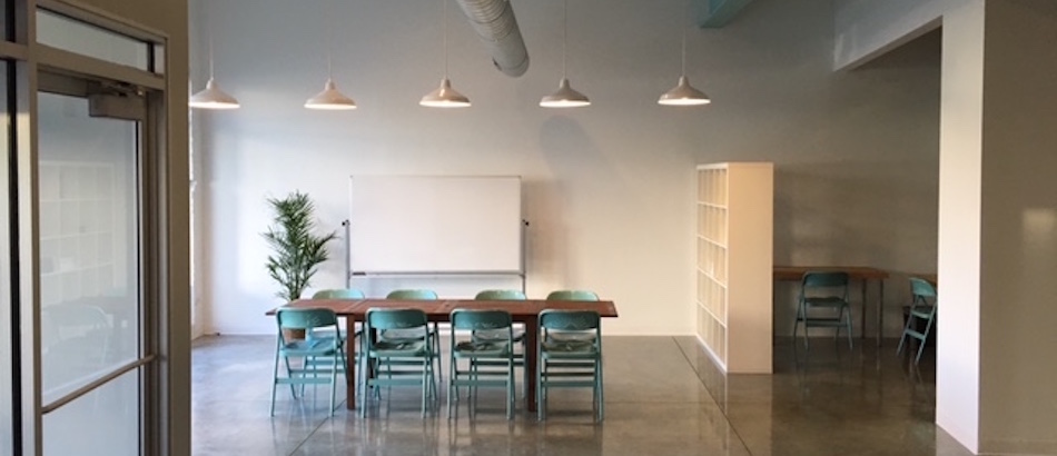 meeting room with aqua chairs and whiteboard