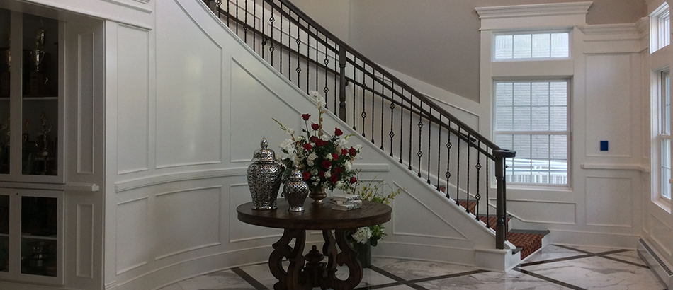 Entrance with marble floors and grand staircase