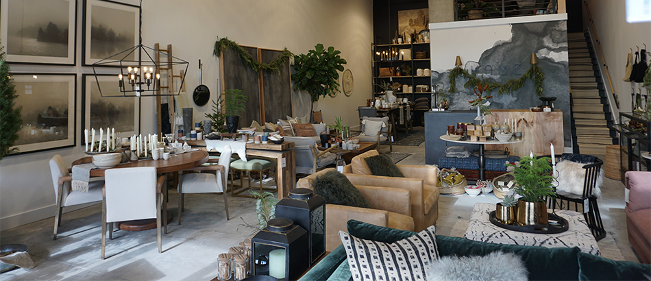 Home store shop interior with greens, greys, browns and blacks