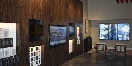 Waiting area with tv screens and samples
