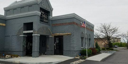 Peterson's Facade - grey painted brick