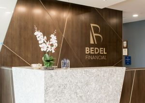 Photo of logo on wall at Bedel Financial Consulting
