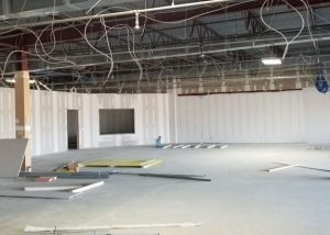 Office space in progress with exposed wiring