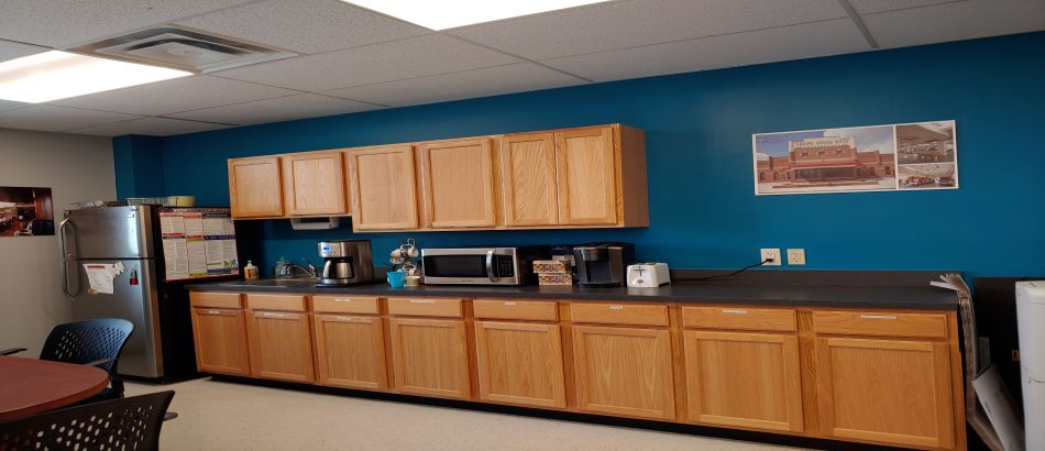 Break Room interior with oak cabinets and blue wall